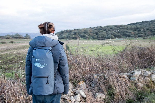 Woman wearing 30 liter DryTide waterproof backpack