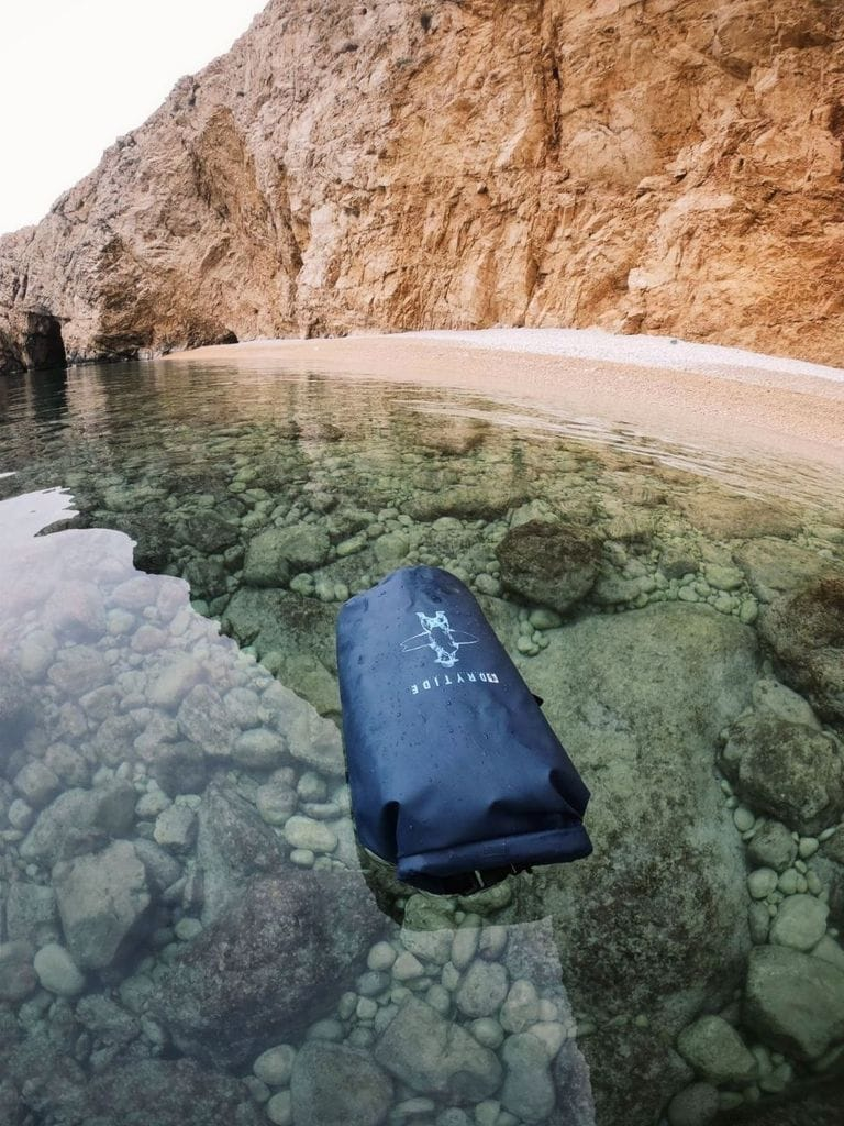 dry bag floating on sea surface