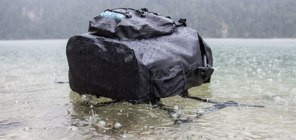 Waterproof backpack floating on water