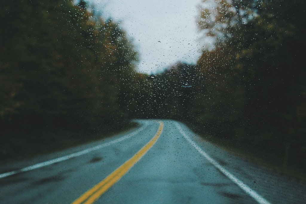 Rain falling on an empty road perfect for motorcycle