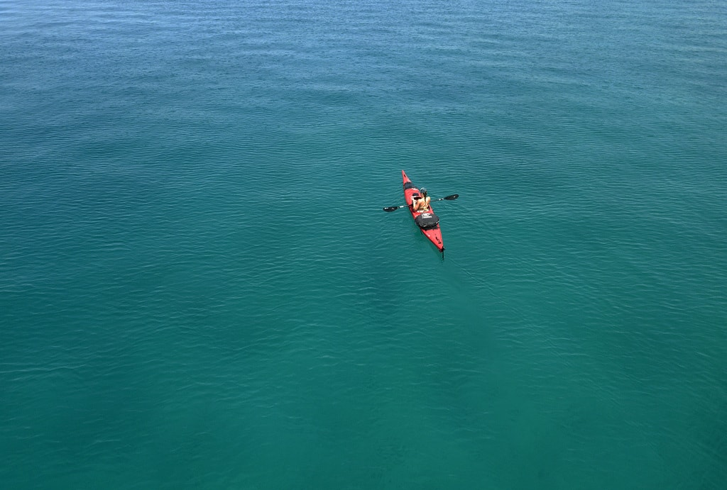 Kayak touring over open sea