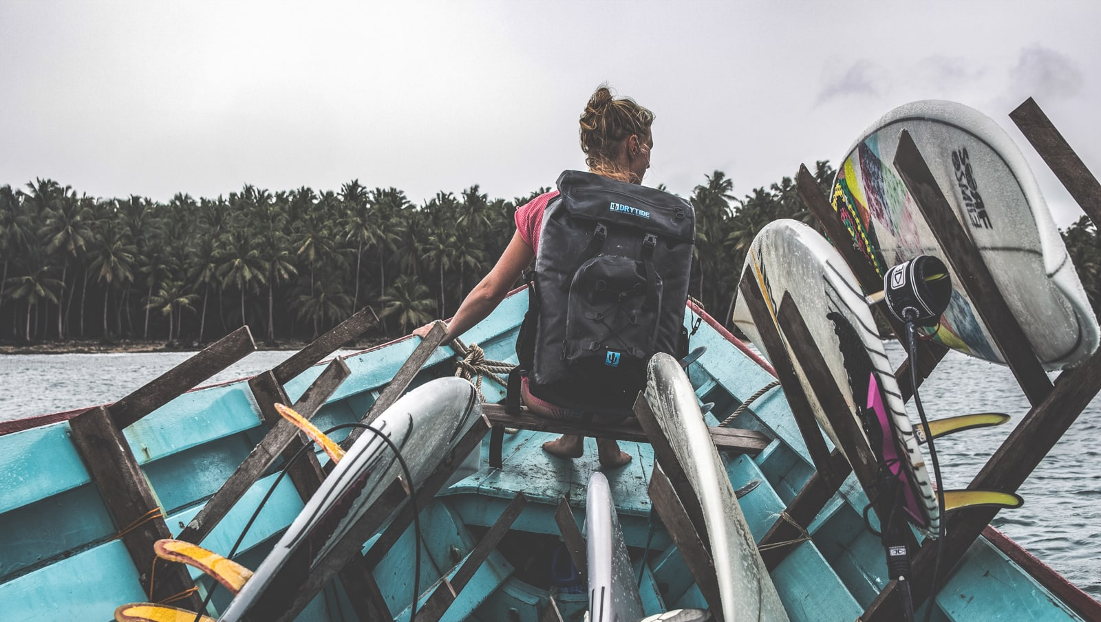 Travelre with a waterproof backpack on a boat