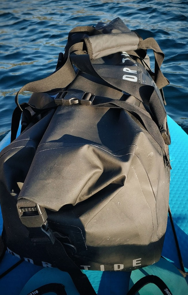 Waterproof duffel bag on the paddleboard