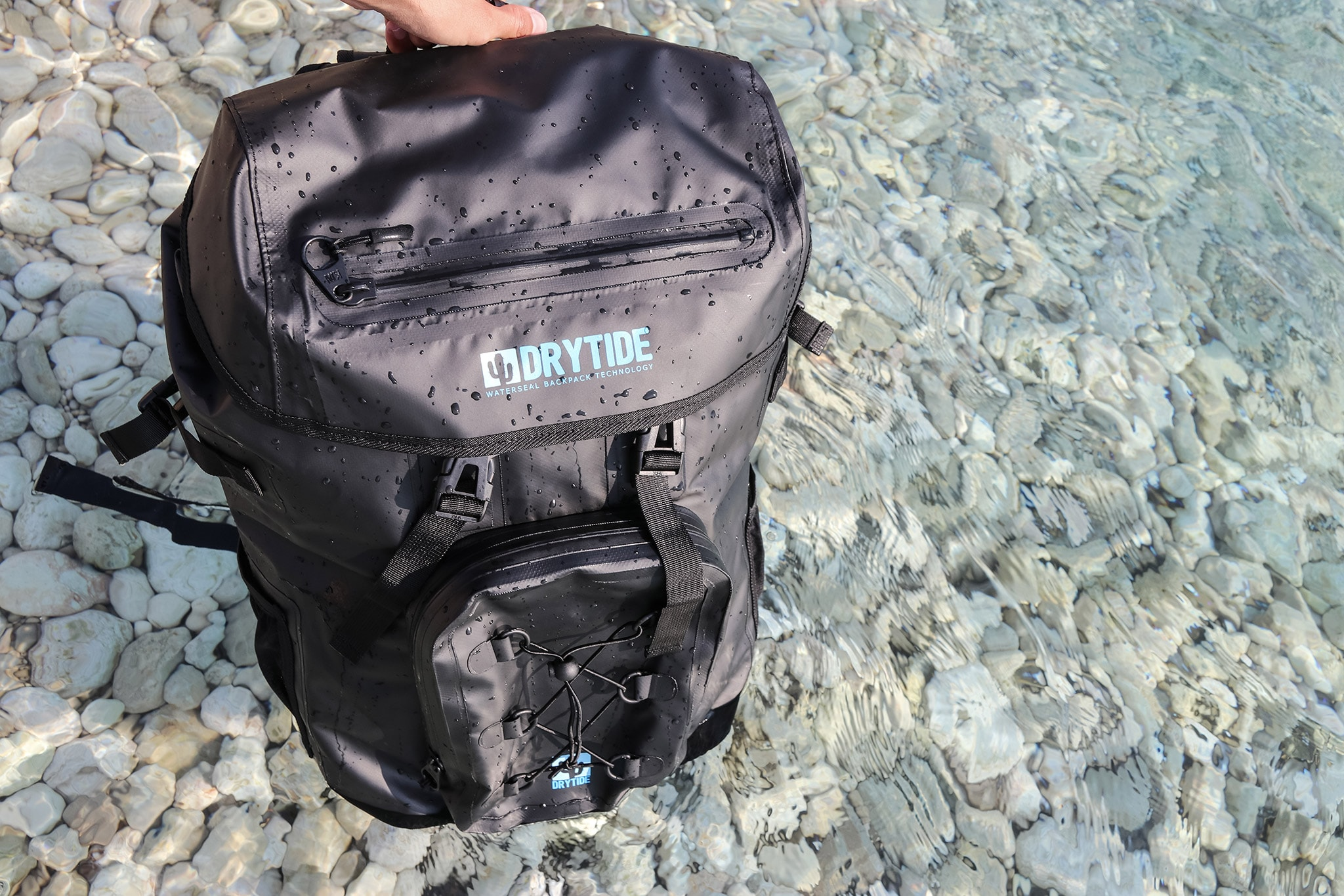 Waterproof backpack floating in the sea